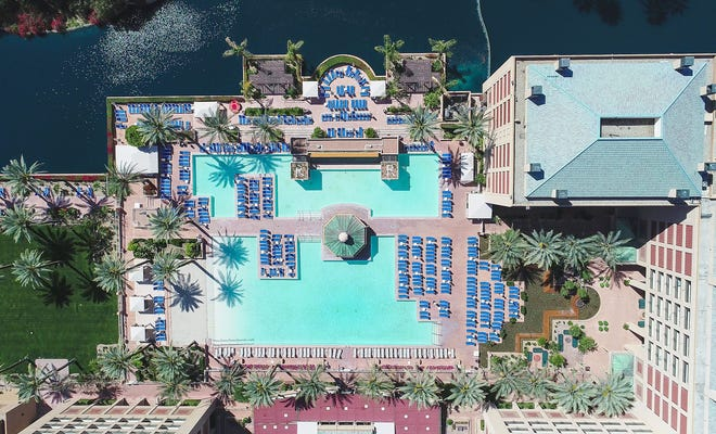 The pool at the Renaissance Esmeralda Resort and Spa in Indian Wells sits empty of people during the height of tourism season because of the coronavirus, March 25, 2020.