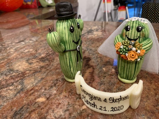 The cake toppers, designed by Georgiana Lotfy and purchased from an Etsy designer in Italy, were quarantined for two weeks, just to be safe.