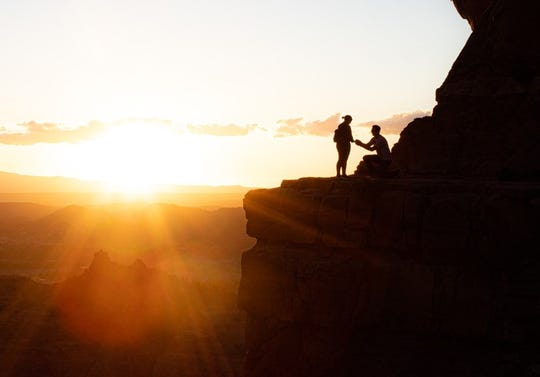 Nicola Robb snapped a photo of a proposal during sunset while hiking Cathedral Rock in Sedona on March 21.