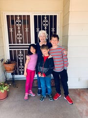 Marjorie Conder with Eloise Moore, 7; Andrew Moore, 8; and Jacob Moore, 11.
