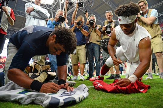 Seattle Seahawks quarterback Russell Wilson (3) and Arizona Cardinals quarterback Kyler Murray (1) exchange jerseys after a game at State Farm Stadium last season. They could be contending for the NFL MVP Award in 2020.
