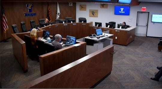 A screen grab of a Tempe City Council meeting shows Mayor Mark Mitchell and three staff members were the only ones physically present during the March 26 meeting. Other council members dialed in.