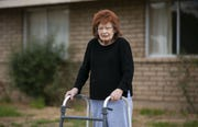 Rose Yozzo, 91, is living alone through the coronavirus pandemic. She has lived alone since her husband passed away two years ago.  She is seen in front of her Tempe home on March 27, 2020.