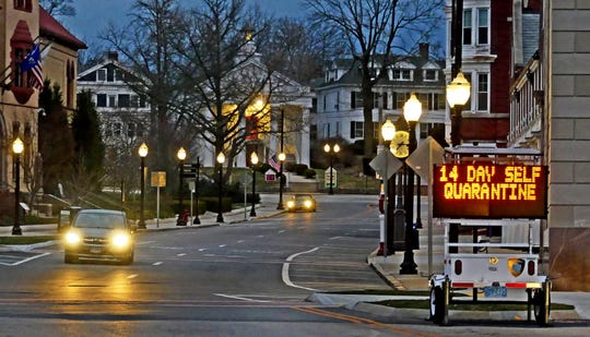 An electronic sign in downtown Westerly, R.I. Thursday, informs motorists coming of a quarantine policy announced by Gov. Raimondo. Travelers from New York will be required to self-quarantine for 14 days upon arriving in the state.