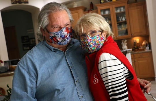 Penney and George Leezy of the Soroptimist Seamstresses group pose for a portrait with masks that they had sewn in their home in Spanish Springs  on March 27, 2020.