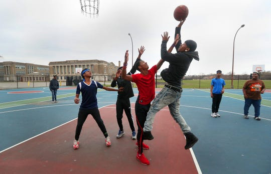"""Like many young people throughout the United States, these teens did not make any effort to observe the universal recommendation of social distancing as the played basketball behind the Edgerton Community Center. When asked if they were concerned about the coronavirus outbreak most said no and one asked, """"what virus""""?"""