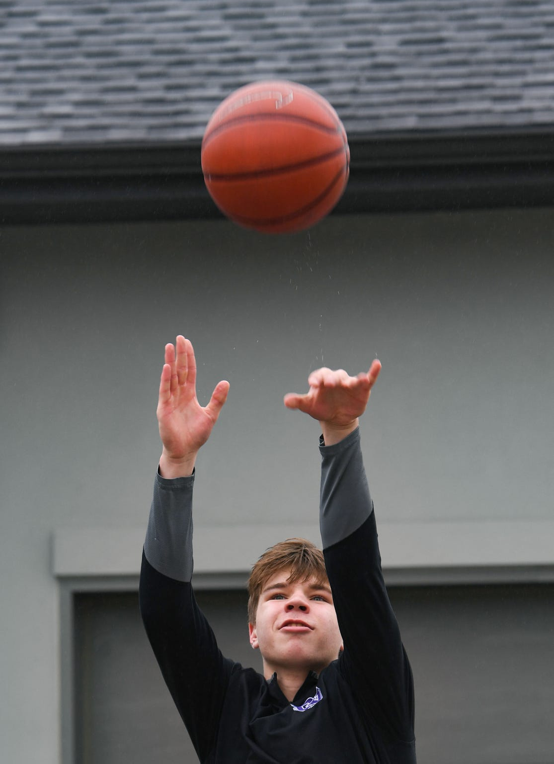 Dakota Valley junior Paul Bruns practices shooting on Friday, March 27, at his home in Jefferson, SD.