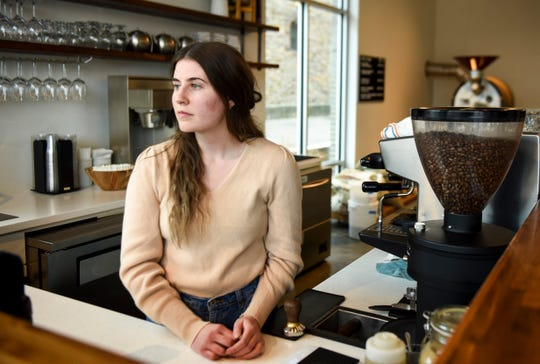 Ashtyn Moural, a barista at The Source, poses for a portrait on Friday, March 27, 2020 in Sioux Falls, S.D. The Source has switched to to-go orders only and is limiting staff to prevent the spread of the coronavirus.