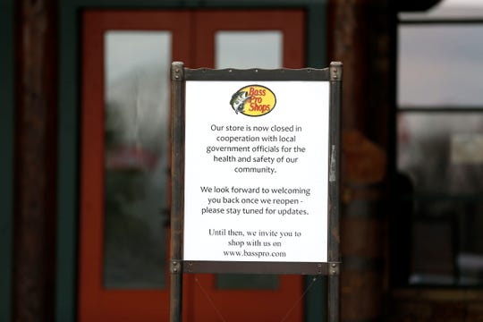 A sign out front of Bass Pro Shops on Friday, March 27, 2020 notifying guests that the store is closed due to the coronavirus shutdowns.
