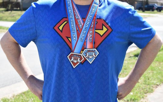 Those who complete the 5K and 10K Sock & Undie Rundie virtual races on April 4 will receive these finisher medals.