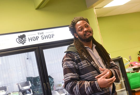 The Hop Shop owner Desi Hall talks about what he will miss about his business Friday, March 27, 2020, in St. Cloud.