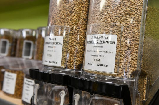 Bins with many varieties of grain used in homebrewing are on display Friday, March 27, 2020, at The Hop Shop in St. Cloud.