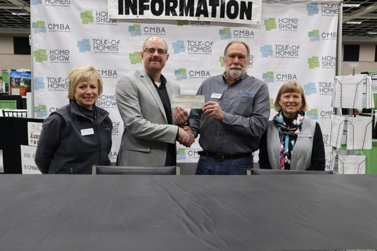 The Central Minnesota Builders Association contributed $1,000 to Habitat for Humanity.