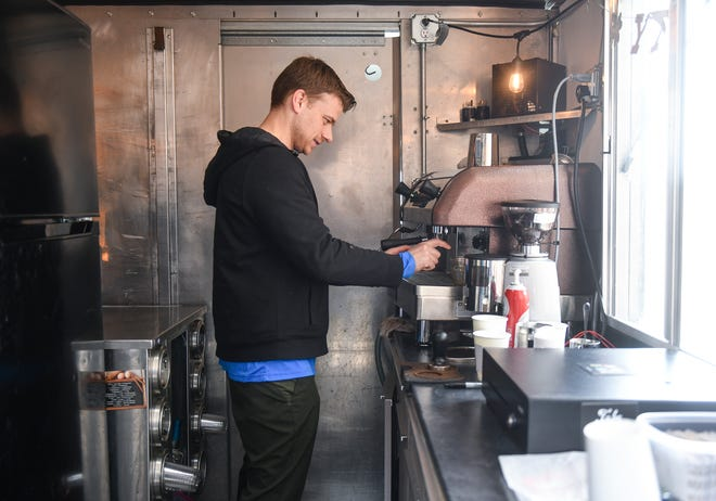 Ryan Voeller makes fresh shots of coffee inside the Adventure Coffee MN truck Friday, March 27, 2020, in Sartell.