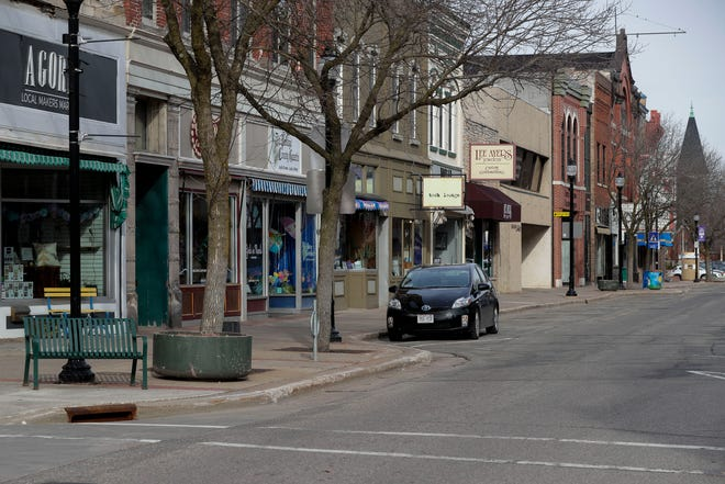 Stevens Point City Council members hope allowing people to carry open alcoholic beverages in plastic cups outside in the downtown area will help taverns and restaurants hurt by the COVID-19 pandemic.