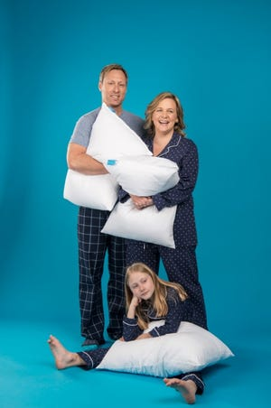 Aaron and Adrianne Kautz, and their daughter, Addison, pose with their One Fresh Pillow products.