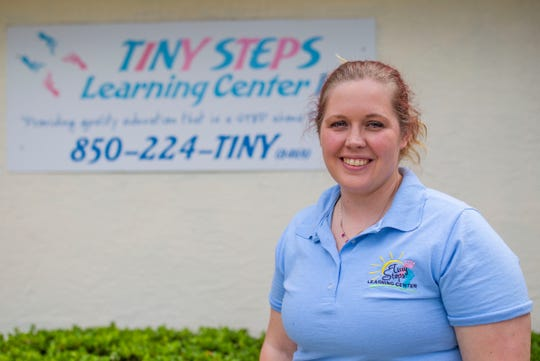 Cassandra Branch, owner of Tiny Steps Learning Center, poses for a photo outside her facility. Branch shared what it is like in the childcare industry during the coronavirus pandemic, Friday, March 27, 2020.