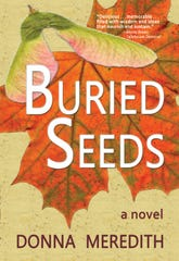 The front cover of Donna Meredith's novel, Buried Seeds (Wild Women Writers, 2020)