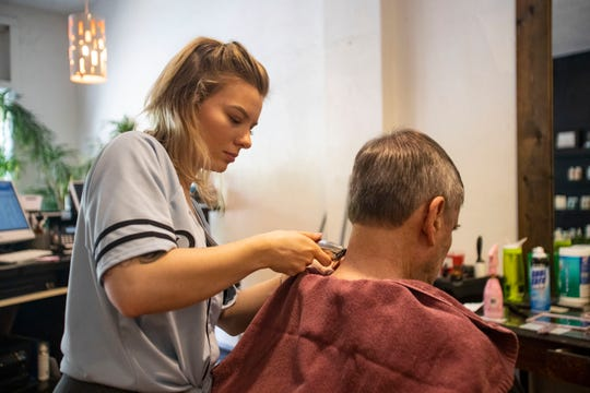 Jeanette Fritz, a hairdresser at Hair on Earth, shaves her client's neck. Hair on Earth is one of the first Tallahassee businesses to receive emergency funding from the Office of Economic Vitality, Friday, March 27, 2020.