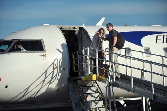 Eric Menger (right), airport director at Vero Beach Regional Airport, and his wife, Kelly, board the 50-seat passenger jet for the first flight of Elite Airways commercial service in December 2015, at the airport. All 50 seats were sold out for the trip to Newark, New Jersey, beginning their new passenger air service between the two cities.