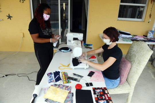 "Fashion designer Kallee Jackson, along with assistant, Jennifer Orazi, work on making face masks on Jackson's back patio on Friday, March 27, 2020, in Port St. Lucie. ""As we've gotten further into this coronavirus crisis, my business has completely stopped,"" Jackson said. ""But, I have the fabric, so why not help out by making face masks."" When an order for a face mask is placed, Jackson donates two masks to a local organization. Jackson has already donated about 100 masks."