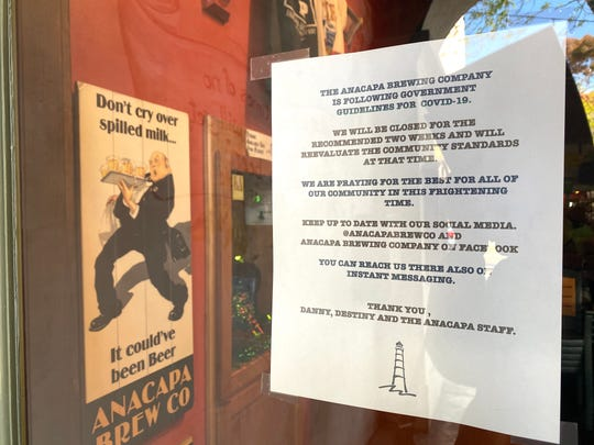 A temporary closure sign is seen at Anacapa Brewing Co. in downtown Ventura. It is one of hundreds of Ventura County businesses closed during the COVID-19 crisis.