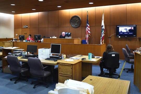 Ventura County Superior Court Commissioner William Redmond conducts court business using video technology in March after a stay-home orders were issued in the county and state to protect against the threat of COVID-19.