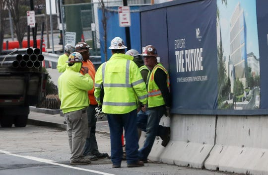 Construction workers take a break outside the site of a White Plains Hospital project on Maple Avenue in White Plains March 20, 2020.