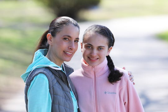 Jennifer Fox and her daughter Julia Casale, 15, during a walk at Nelson Park in Ossining, New York March 27, 2020. They've been going for walks or hikes for physical education class. Fox has been homeschooling her daughter, a high school freshman who has autism, with guidance from her teachers during the coronavirus pandemic. Fox is navigating this while doing her own job as art teacher, virtually guiding her students in the Bronx.