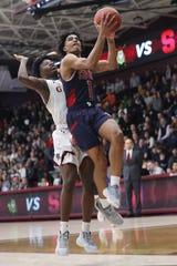 Stepinac's R.J. Davis (1) puts up a shot in front of Iona's Keeshawn Jones (11)  during basketball action the Hynes Center at Iona College in New Rochelle Feb. 1, 2020. Davis is the Journal News/lohud boys basketball Player of the Year