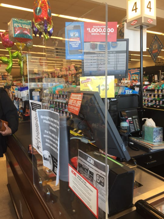 Businesses that have remained open during the coronavirus pandemic have had to come up with creative ways to ensure customers practice social distancing.