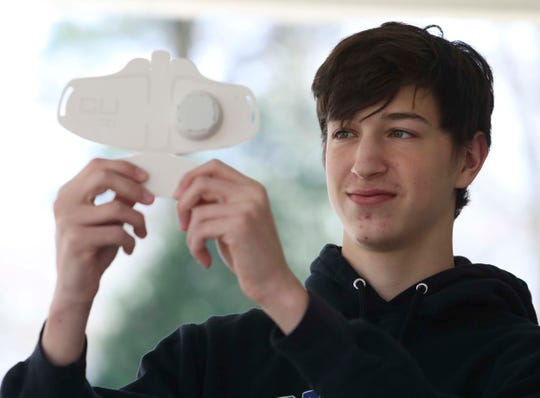 Brandywine High School's Joe Bockrath holds one of the mask components he and other students are creating at home with 3D printers while their school building is shut down.