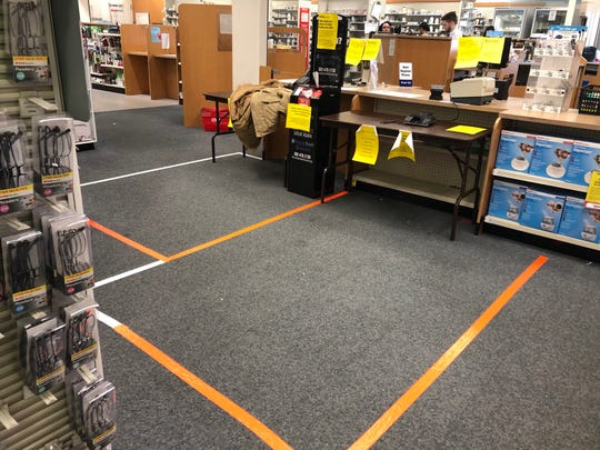 Businesses that have remained open during the coronavirus pandemic have had to come up with creative ways to ensure customers practice social distancing, such as taping 6-foot squares on the floor. This is the CVS near Trolley Square.