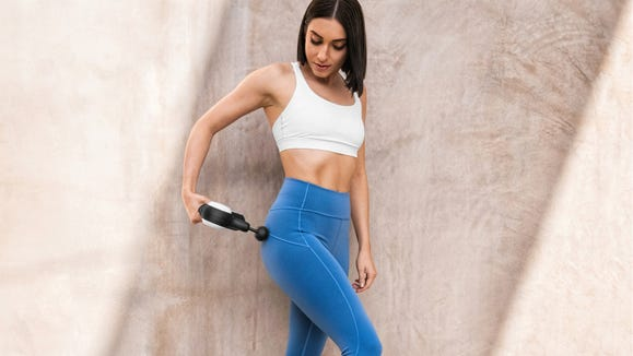 Target sore muscles with the Theragun.