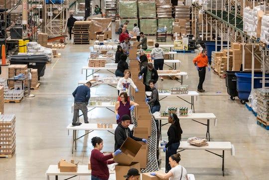 Volunteers help break down and repackage food in Chicago on March 24, 2020.