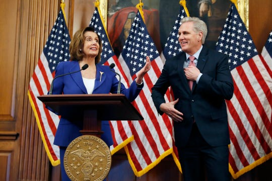 House Speaker Nancy Pelosi, D-Calif., and House Minority Leader Kevin McCarthy, R-Calif., participate in a bill enrollment ceremony for the Coronavirus Aid, Relief and Economic Security Act.