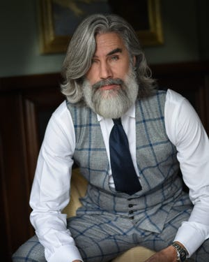 "Greg Berzinsky, 58, known as the ""Zeus of beards,"" encourages men to embrace their beards (and their grey hairs)."