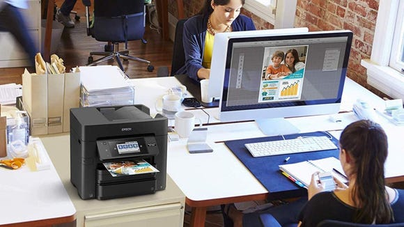Print any document, shipping label, or photograph with the Epson.