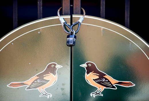 A general view of a lock on the main entrance gate on what was supposed to be opening day between the New York Yankees and Baltimore Orioles at Oriole Park at Camden Yards.