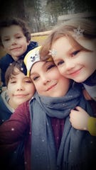 Amanda Lovern (center) with her three children. Lovern, 32, died on March 19, one day after she was tested for the novel coronavirus. Her family is still waiting on the result.