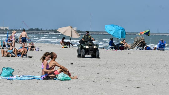 A sheriff's deputy patrols the beach in Cape Canaveral Saturday afternoon. The county chose not to close its beaches between 11am and 4pm as several municipalities have done due to the coronavirus pandemic.