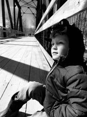 Athena Scheidet's son, Owen, rests on a bridge, one of his favorite spots. March 15, 2020.