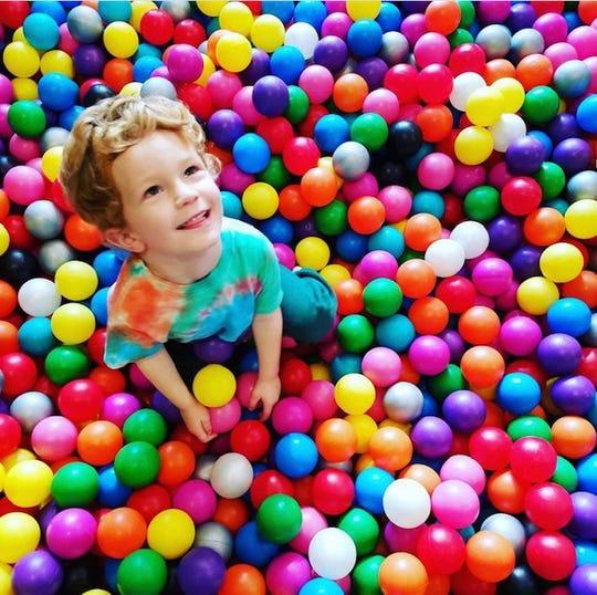 Athena Scheidet's son, Owen, plays in an indoor jump park in New York. Dec. 2018.