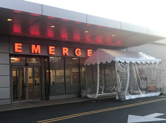 A tent stands outside the emergency department at Jefferson Cherry Hill hospital, where COVID-19 testing is being offered in a different area.