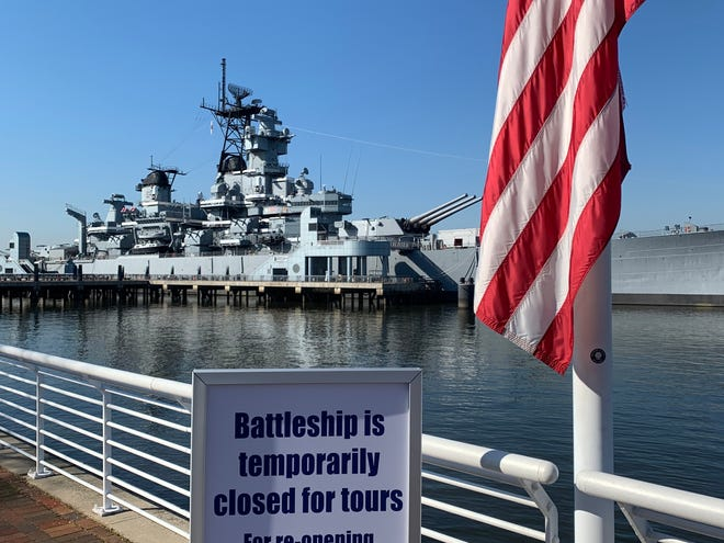 The retired battleship New Jersey, BB-62, sits closed to the public as a floating museum on the Delaware River in Camden under orders by New Jersey Gov. Phil Murphy to help  prevent the spread of the highly contagious coronavirus pandemic.  Murphy's state of emergency calls for closure of all nonessential businesses and for he public to stay at home to prevent gatherings of people and to promote social distancing.