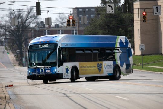 A Metro bus makes its way up Burnet Avenue near UC Health, Friday, March 27, 2020. Earlier in the week, SORTA approved free bus fares during the new coronavirus pandemic.