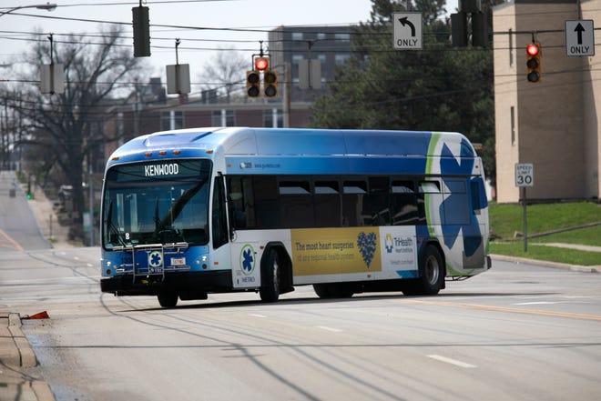A Metro bus makes its way up Burnet Avenue near UC Health.