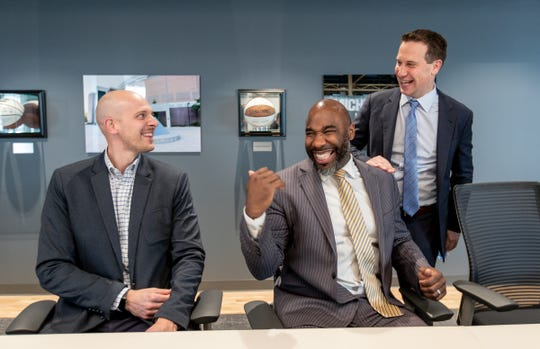 United Shore chief legal officer Adam Wolfe, left, and leadership coach Mateen Cleaves joke with president and CEO Mat Ishbia in the Breslin Center conference room at United Shore headquarter in Pontiac, Friday, Feb. 28, 2020.