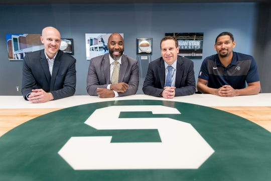 From left, United Shore chief legal officer Adam Wolfe, leadership coach Mateen Cleaves, president and CEO Mat Ishbia and business innovation specialist Charlie Bell pose for a photo in the Breslin conference room at United Wholesale Mortgage headquarter in Pontiac, Friday, Feb. 28, 2020.