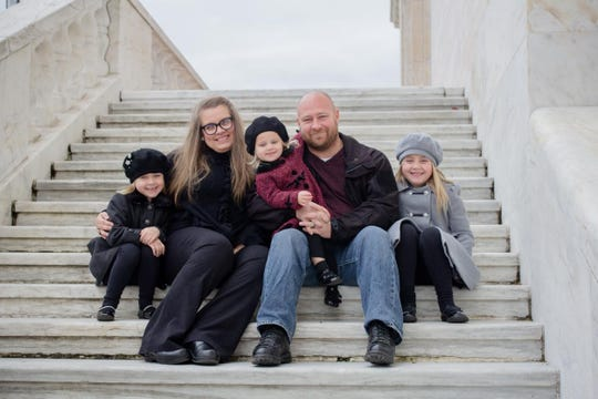 Detroit Police Officer Edward Chesher with his wife, Melissa Chesher, and daughters, from left, Lily, Ivy and Emma. Chesher, who works in the fire investigation unit, said he was told on March 18 he had tested positive for COVID-19. He said his wife also experienced symptoms, but was not tested.